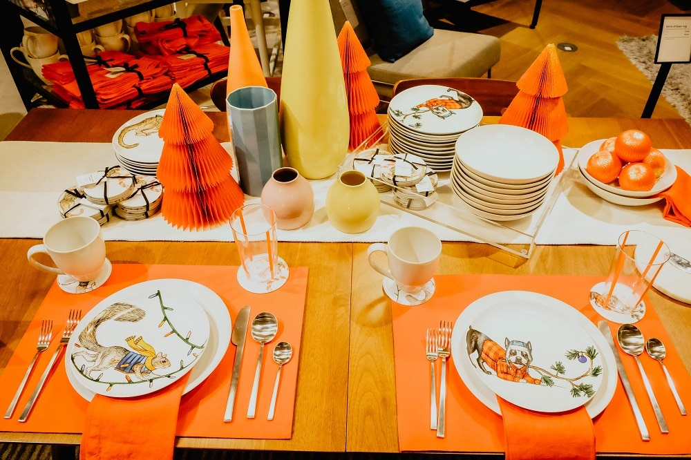 For a balanced look, mix elements that hint of a holiday theme with everyday place settings.
