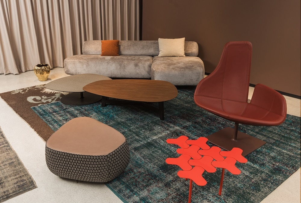 From Moroso, the Gogan sofa and the Fjord armchair and stool with the Phoenix low tables, all by Patricia Urquiola are accompanied by the Nanook by Philippe Bestenheider