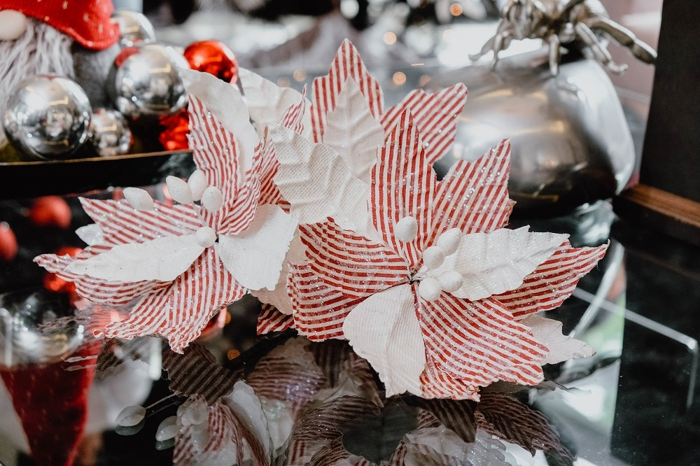 You may cluster flowers together when decorating your Christmas tree.