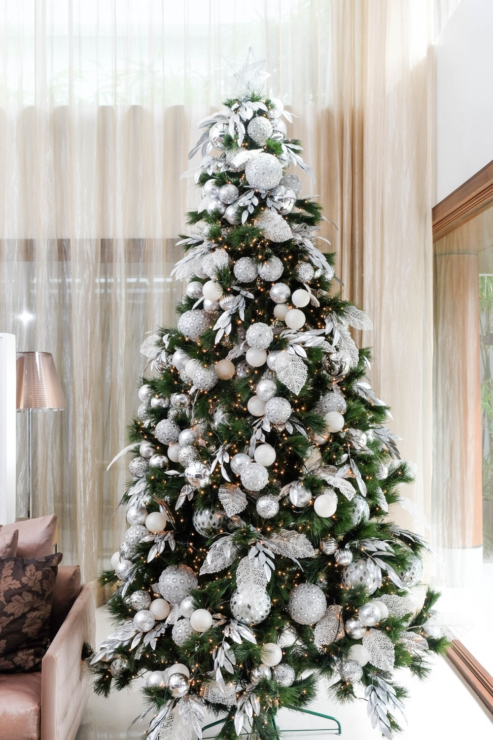 Here Is How You Can Elevate A Simple Silver And White Christmas Tree Metro Style