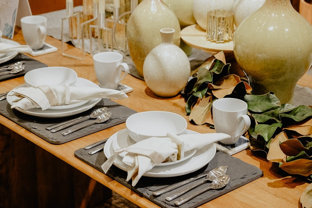 The use of unexpected pieces is a surefire conversation starter. Here, Anton Barretto uses cheeseboards from west elm as chargers in this place setting.