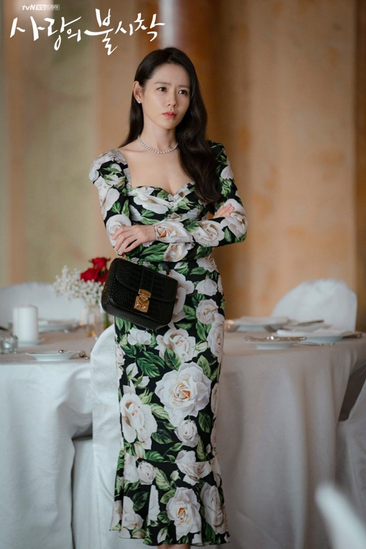Long and lean in a floral Dolce & Gabbana dress on the set of Crash Landing on You