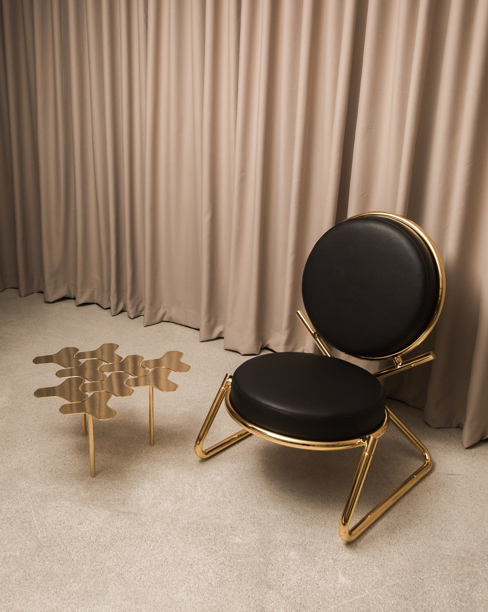 From Moroso, The Double Zero chair by David Adjaye and the Nanook low table by Philippe Bestenheider