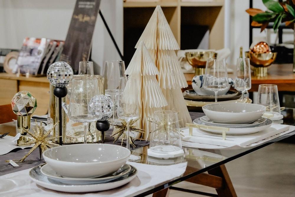 Get creative with the usual items you have in your arsenal of tabletop implements. Anton used candlesticks and jiggers by west elm as bases for ornaments in his table setting.