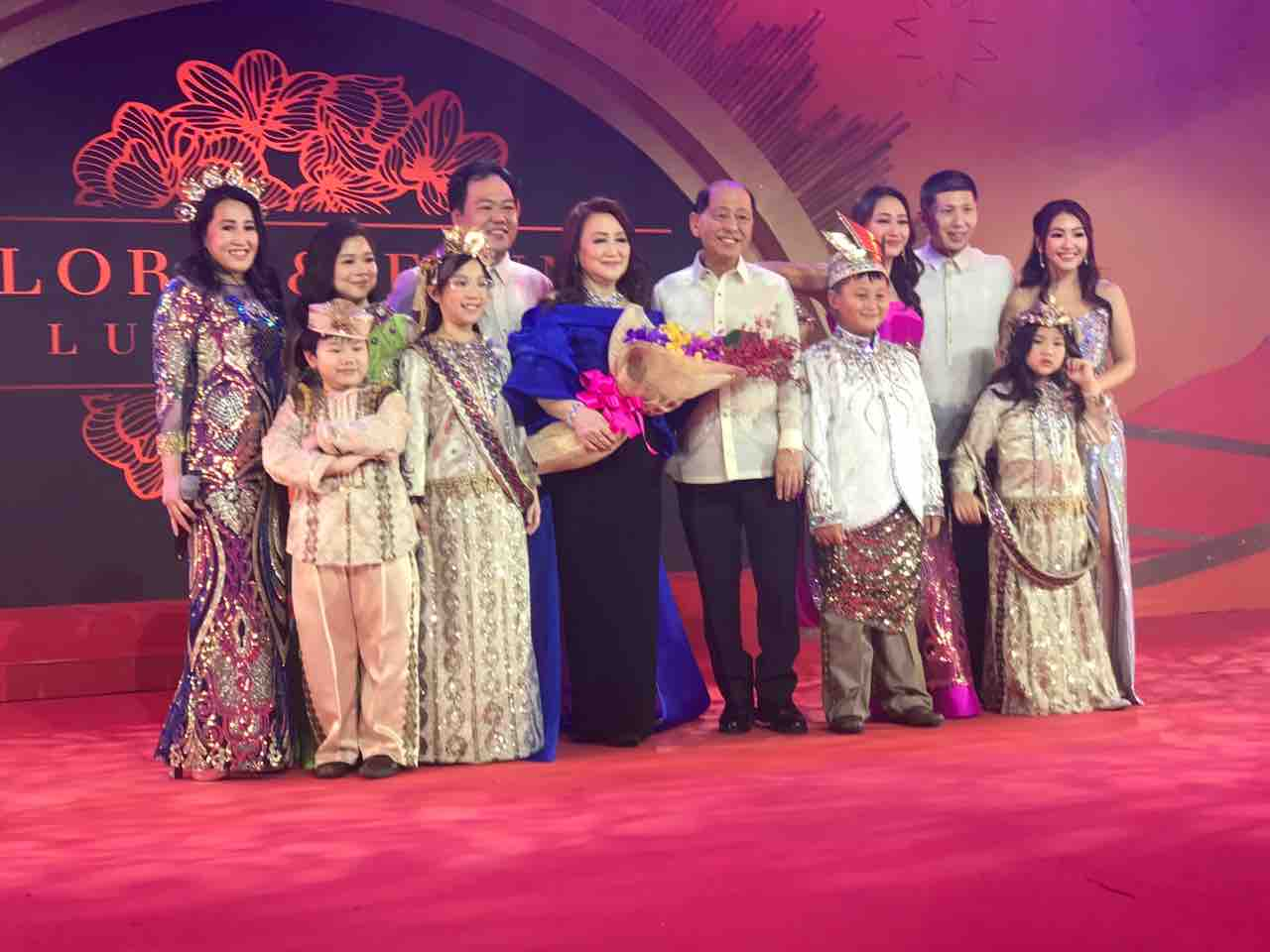 Enrique Chua joins his wife Flora and the rest of their family onstage.